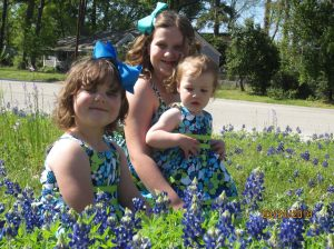 My girls all dressed up and playing in the flowers.