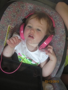 I can't tell if she's listening to good music or just drowning out the sounds of her sisters.