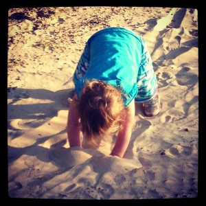 Digging in the cool sand