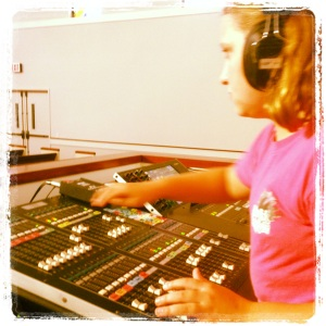 working the sound board during Praise Band practice