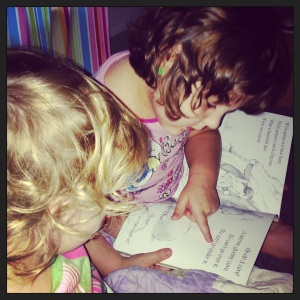 Stories before bed are much better when your big sister reads them