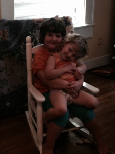Danielle in the same rocking chair holding Jillian on her second birthday.