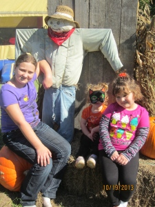 My girls with the scarecrow
