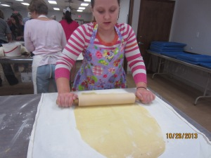 rolling out the dough- they had a stick that you had to measure the size of your strudel with, it had to be just right.