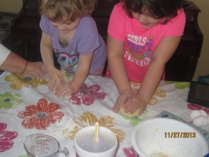 my little chefs rolling out the dough
