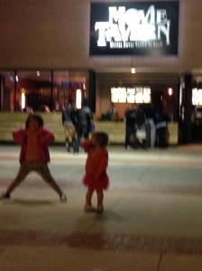 Making shadows outside the movie theater!