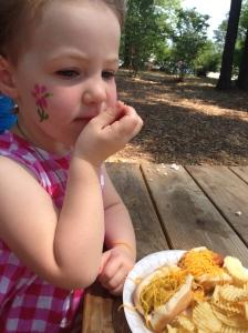Everyone loves a hotdog on a picnic table.