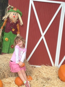 Just sitting outside the barn with a scarecrow.